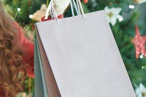smiling young woman showing shopping