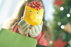 Closeup on yellow piggy bank in hand