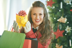 smiling young woman shopper showing