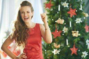 happy trendy woman in red dress near