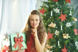 happy young woman with green Christm