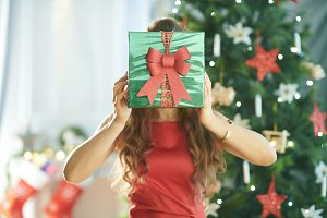 young woman holding green Christmas