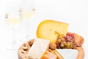 Cheese plate with grapes and white