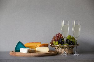 Cheese and grapes in wicker basket