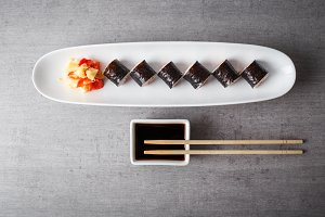 Maki sushi served in long plate on