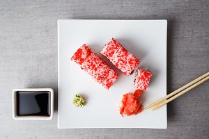 Sushi served in plate on grey table