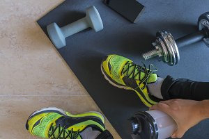 Dumbbell and mat training at home,