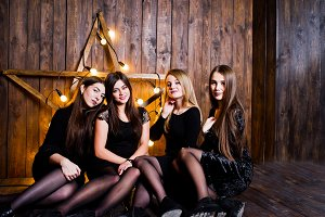 Four cute friends girls wear black d