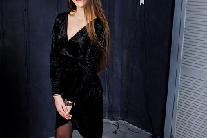 Cute girl wear on black dress agains