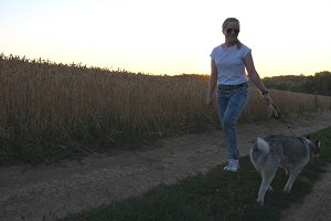 Happy girl holding golden wheat