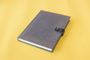 Notebook on yellow background.