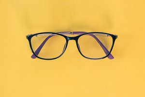 glasses on yellow background.