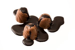 Chocolate bonbon with syrup isolated