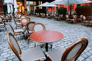 Tables and chairs at cobbled square