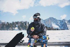 Bearded snowboarded in sunglass mask