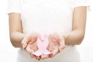 Woman holding a pink ribbon.
