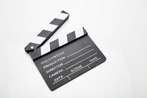 Film slate lying open against white