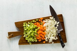chopped vegetables and a chef's knif