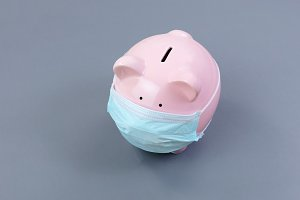 Piggy bank with medical mask