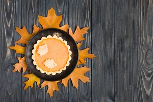 Pumpkin pie with cinnamon and cookie