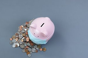 Piggy bank wearing medical mask