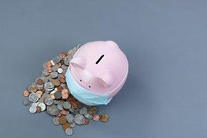 Piggy bank wearing medical mask