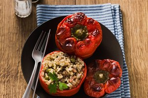 Ready baked stuffed peppers in a pla