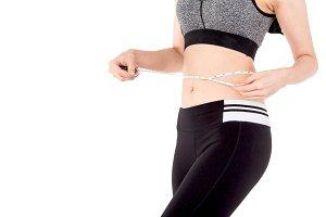 Woman slim measuring her waist