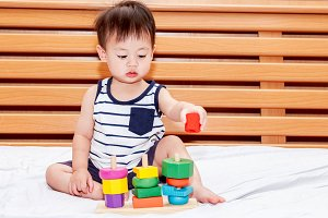 Baby boy playing with wooden blocks