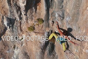 woman rock climber climbing on the