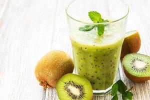 Glass of kiwi smoothie with fresh fr