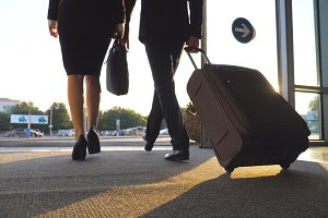 Business man and woman with luggage