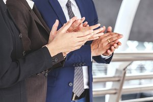 Business people clapping hands