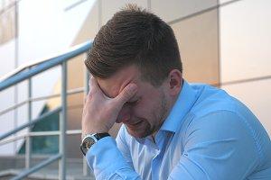 Side view of upset sad businessman