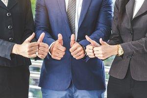 Business teamwork show thumb up