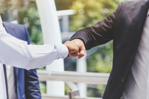 Businessman giving fist bump