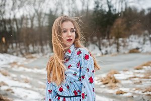 Stylish girl in dress at winter day