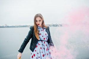 Stylish girl in leather jacket hold
