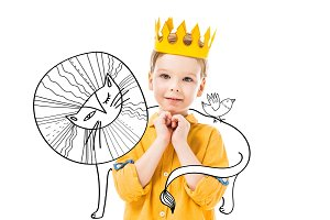 adorable boy in yellow crown with pl