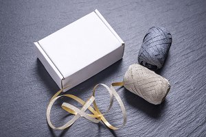 White cardboard gift box and ribbon
