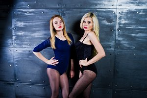 Two elegante blonde girls wear on co