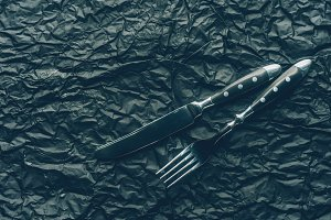 close up view steel fork and knife o