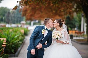 Beautiful wedding couple kissing out