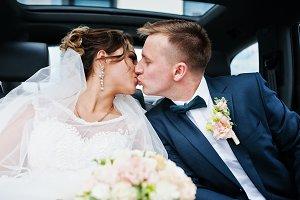 Beautiful wedding couple sitting in