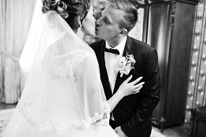 Wedding couple kissing in the room o