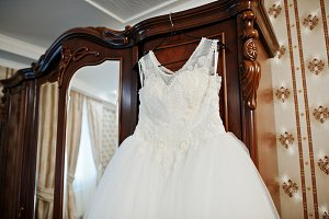 Wedding dress hanging on the rack on
