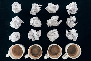top view of crumpled papers and cups