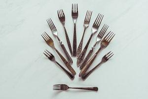Composition of old metal forks on wh