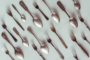 Vintage spoons and forks on white ta