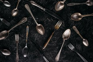 Vintage spoons and forks with knives
